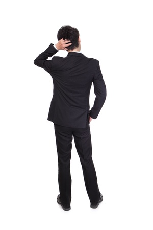 Back pose of a business person thinking. Isolated over white background, full body, asian modelの写真素材