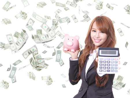Savings woman smiling holding pink piggy bank and calculator with money rain