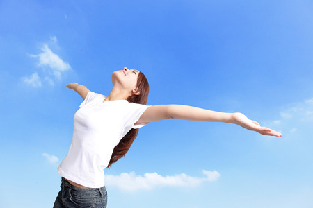 Photo pour Happiness freedom concept. Woman happy smiling with arms up, asian beauty - image libre de droit