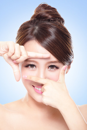 Woman face and eye care and she making frame with hands, asian womanの写真素材