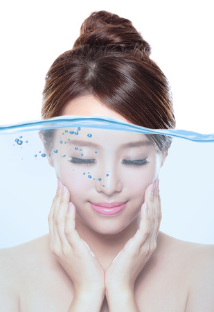Portrait of beautiful woman with young clean skin under the water , skin care and moisturizer concept, asian