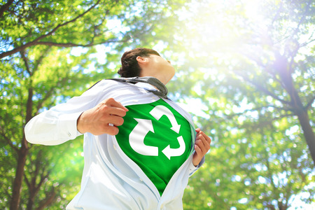 ECO concept - Business man opens his shirt to show off recycle mark in forest trees, asian