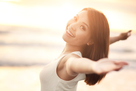 Photo pour Smile Freedom and happiness woman on beach. She is enjoying serene ocean nature during travel holidays vacation outdoors. asian beauty - image libre de droit