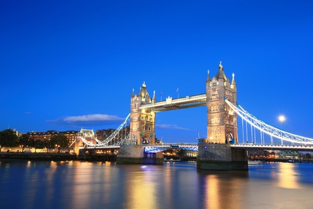 Photo pour Tower Bridge with reflections in the thames river at sunset in London, United Kingdom, England - image libre de droit