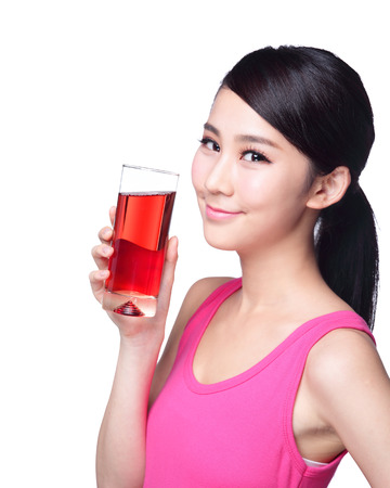 Young happy woman drink juice ( red cranberry ) isolated on white background, asian
