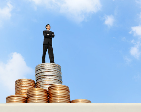 I want be rich - Successful business man stand on money with blue sky, asian male