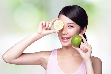 Health girl show lemon with smile face, health food concept, asian woman beauty