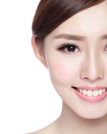Half portrait of the woman with beauty face, perfect skin and health teeth, she smile to you isolated on white background, asian beautyの写真素材