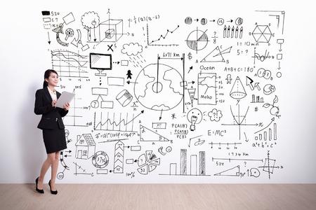 Foto de business woman using digital tablet pc computer with hand drawing infographic background, asian - Imagen libre de derechos