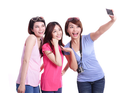 Selfie - Happy teenagers woman taking pictures by themselves isolated on white background, asianの写真素材