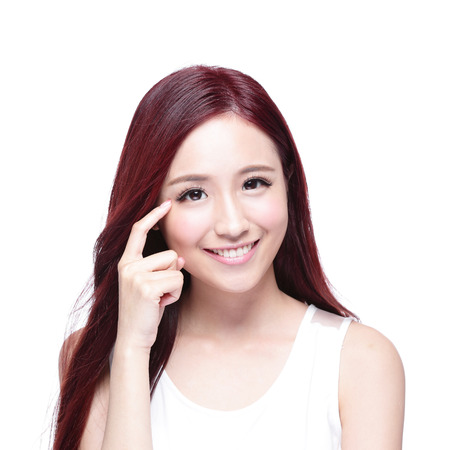 Beautiful Woman smile pointing her eye with health long straight hair, concept for health eye care,  asian beauty model