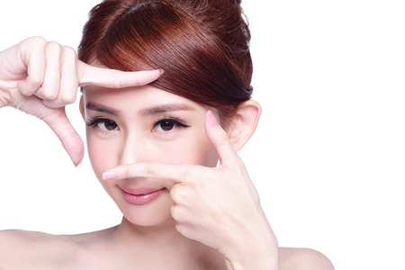 Photo for Woman face and eye care and she making frame with hands, asian beauty - Royalty Free Image