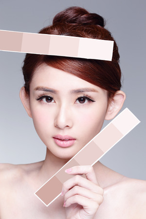Beauty Skin care woman showing skin color paper, with clean face skin, concept for skin care, asian