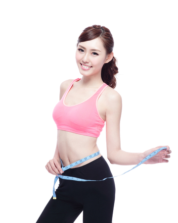 Health concept, Sport girl hold measure tape isolated on white background. asian beauty