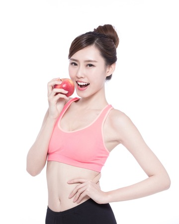 Happy health woman show apple benefit to health, asian beauty