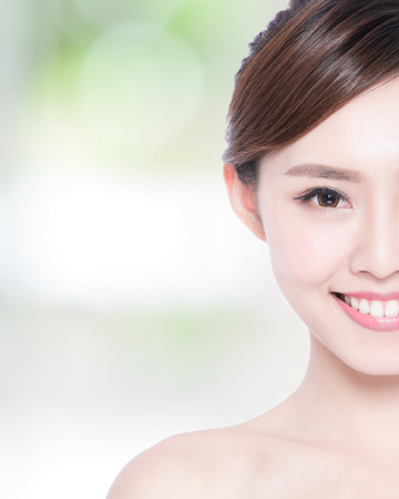 Photo for Half portrait of the woman with beauty face, perfect skin and health teeth, she smile to you with nature green background, asian beauty - Royalty Free Image
