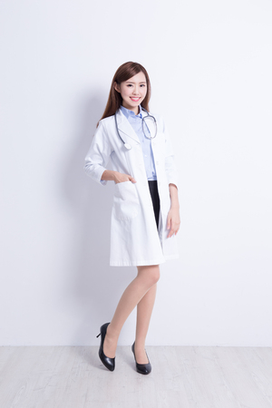 Photo pour Smiling medical doctor woman with stethoscope. with white wall background. asian - image libre de droit