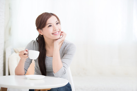 Foto de smile young woman holding cup of coffee or tea at home, healthy lifestyle concept, asian beauty, asian beauty - Imagen libre de derechos
