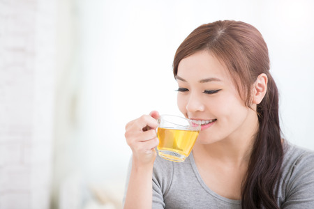 Photo pour smile young woman holding cup of  green tea at home, healthy lifestyle concept, asian beauty, asian beauty - image libre de droit