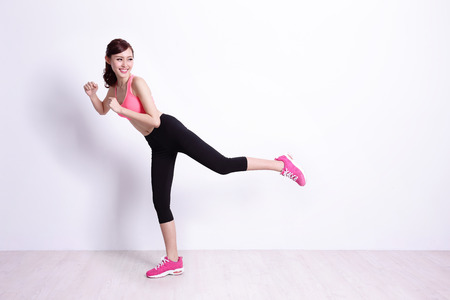 Photo for sport woman is doing exercise with white wall background,asian beauty - Royalty Free Image
