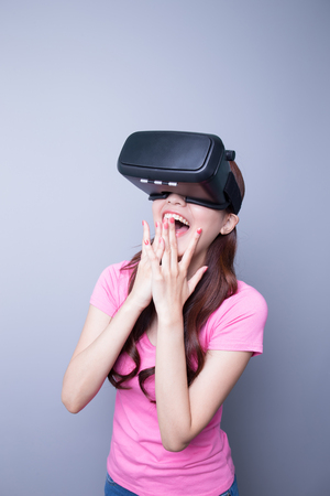 Photo pour Excited happy woman watching the virtual reality headset, asian beauty - image libre de droit
