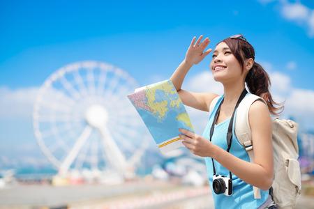 Photo pour Happy woman travel with ferris wheel, hong kong, asian beauty - image libre de droit