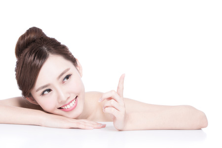 Photo for Charming woman Smile and show something while lying isolated on white background, asian girl - Royalty Free Image