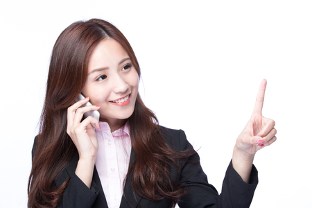 Foto de Young Business woman show empty copy space and smile talking on the mobile phone isolated on white background, model is a asian beauty - Imagen libre de derechos