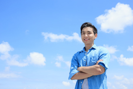 Foto de man smile happily to you with blue sky, asian - Imagen libre de derechos