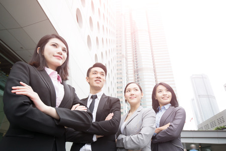 Photo pour Business people team in the office, shot in Hong Kong, asian woman and man - image libre de droit