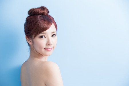 Photo for beauty woman smile to you isolated on bluebackground, asian - Royalty Free Image