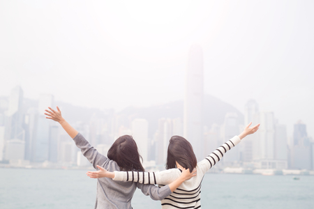 Photo pour two beauty woman feel free and back to you in hongkong - image libre de droit