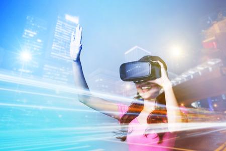 Photo pour Double exposure of happy woman using VR-headset glasses for virtual reality concept - image libre de droit