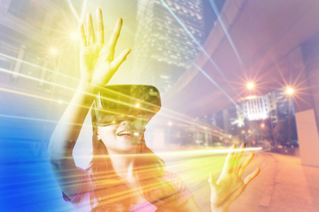 Double exposure of happy woman using VR-headset glasses for virtual reality concept