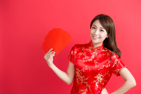 beauty woman wear cheongsam and take Red envelopes  chinese new year