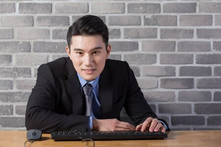 businessman smile to you in the office, asian