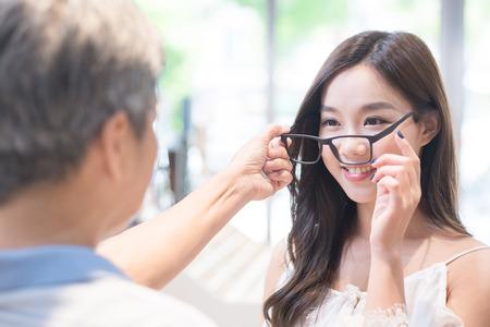 Photo pour beauty woman smile and wear eyeglasses with optometrist - image libre de droit