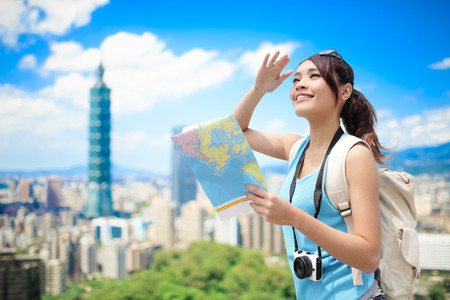 woman take map and look somewhere in taipei