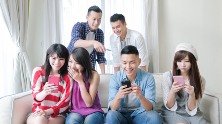 Photo for young people use phone and smile happily - Royalty Free Image