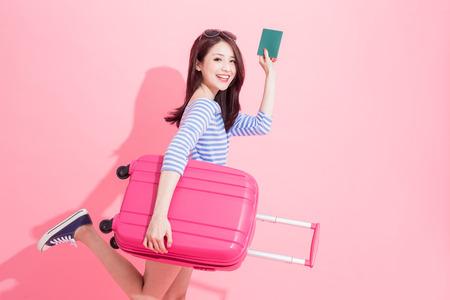 Foto de woman take luggage case and passport with travel concept - Imagen libre de derechos