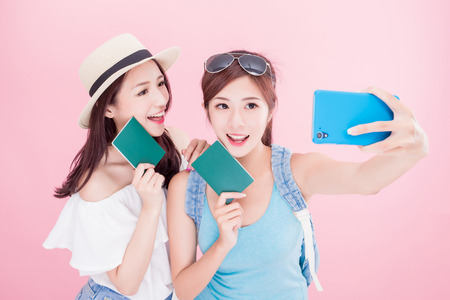 Photo pour two beauty woman selfie happily with travel concept on the pink background - image libre de droit