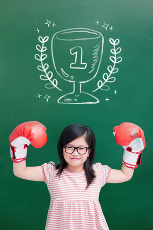 Photo for cute girl wear glove with number one blank green chalkboard - Royalty Free Image