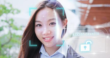 woman use smart phone unlocking with biometric facial identification