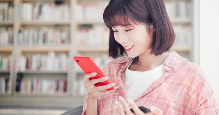 Photo pour Young woman shopping online with credit card and using smart phone - image libre de droit