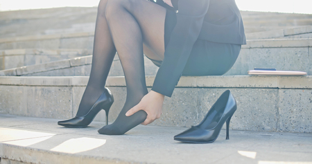Photo pour business woman with leg cramps and ankles pain from high heels - image libre de droit
