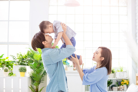 Photo pour happy family with child boy play and kiss at home - image libre de droit