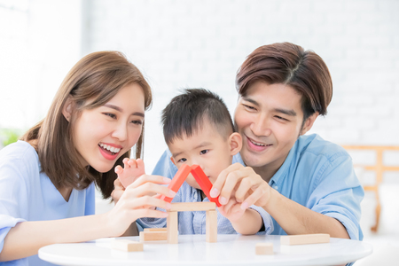 Foto de happy asian family playing with toy blocks - Imagen libre de derechos