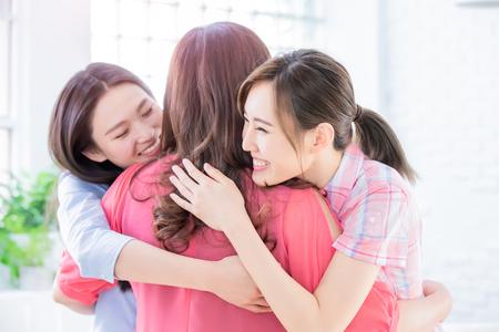 Photo pour Two daughters give mom a hug happily - image libre de droit
