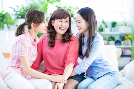 Photo pour two daughters and mother have a good chat or communication happily at home - image libre de droit