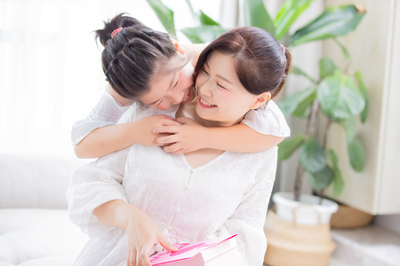 Photo pour Daughter give mom a hug and mom smile happily - image libre de droit